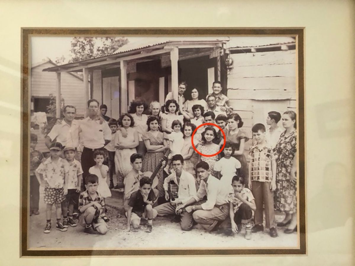 Young Carmen (circled) with her family in Puerto Rico in the 1950s.