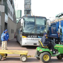 4:17 p.m. Ballpark work carts resume their work once the visiting team bus has parked -