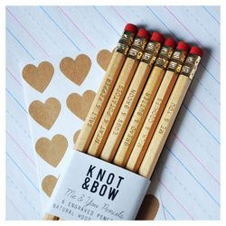 """<b>Knot & Bow</b> Me & You Pencils, <a href=""""http://www.etsy.com/listing/62722740/me-you-pencils-gold-engraved-natural"""">$12</a> at the Etsy Holiday Shop"""