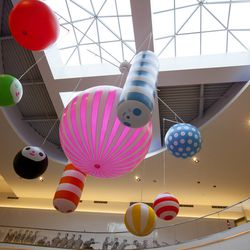 """A colorful mobile by Friends With You (named """"Dream Maker""""). Bonus: It moves! The artists say that it """"represents a miniature solar system that directly relates to your fortune and dreams."""""""