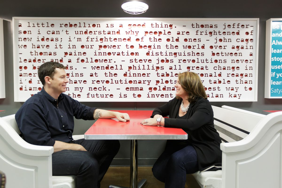 1776 co-founders Evan Burfield and Donna Harris hang out in the dining area of their startup incubator.