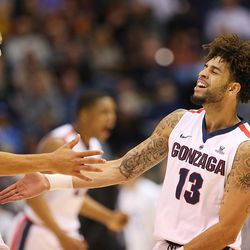 Gonzaga Bulldogs guard Josh Perkins (13) celebrates after a basket as BYU and Gonzaga play in an NCAA basketball game in the Marriott Center in Provo on Saturday, Feb. 24, 2018.