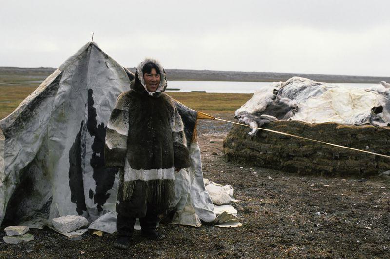 An Inuit man wearing sealskin.