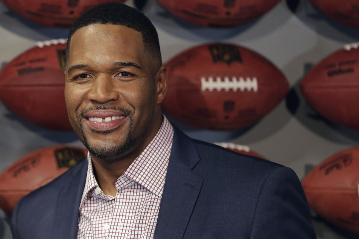 """In this Thursday, Nov. 30, 2017 file photo, Former New York Giant Michael Strahan poses for a picture at the opening of """"NFL Experience"""" in Times Square, New York."""