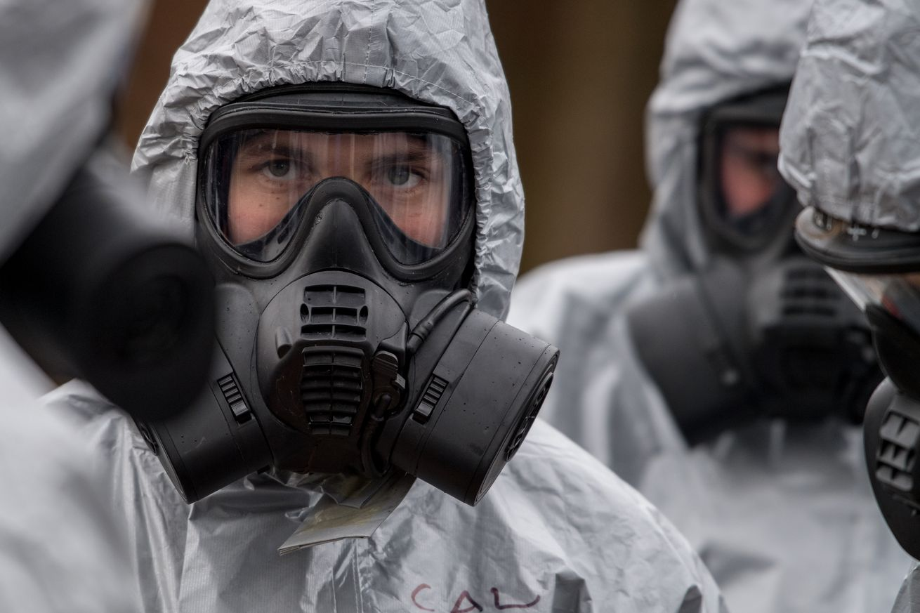 Military personnel in gas masks investigated the Skripal's poisoning in March.