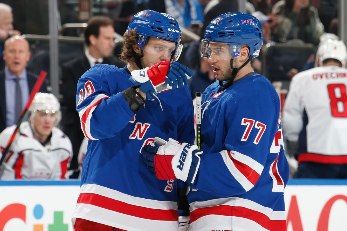 Tony DeAngelo and Artemi Panarin of the New York Rangers talk during a break in the action against the Washington Capitals at Madison Square Garden on March 5, 2020 in New York City.