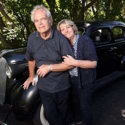 Dr. Terrell Thomson has a medical degree, a Ph.D. — and Alzheimer's disease. He was diagnosed in January, and his wife Debbie is his caregiver. They pose Friday, June 23, 2017, next to a vintage 1937 Plymouth car that Terrell restored.