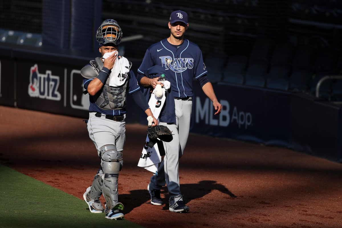 Mike Zunino #10 and Charlie Morton #50 of the Tampa Bay Rays walk toward the dygout prior to Game Three of the American League Division Series against the New York Yankees at PETCO Park on October 07, 2020 in San Diego, California.