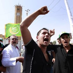 Iraqis chant slogans during a protest in Baghdad, Iraq, Friday, Sept. 14, 2012. Hundreds of Iraqis demonstrated in Baghdad's northern Sunni neighborhood of Azamiyah to protest the anti-Muslim film, demanding the U.S. government to punish those who behind it and not to play it in any country.