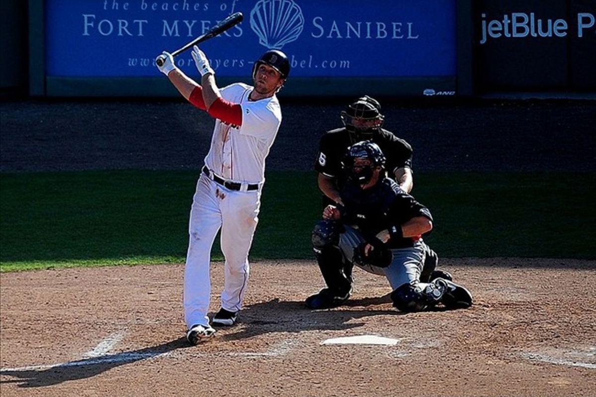 Mar. 4, 2012; Fort Myers, FL, USA; Boston Red Sox first baseman Lars Anderson hits a grand slam against the Minnesota Twins at JetBlue Stadium. Mandatory Credit: Andrew Weber-US PRESSWIRE