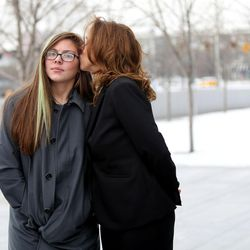 Kathleen Janis gets a kiss from her mother, Kelly Janis, outside  the federal courthouse in Salt Lake City on Wednesday, Feb. 1, 2017. Kathleen, a ninth-grade student at Central Davis Junior High, is suing the Davis School District because she isn't allowed to participate in her school's wrestling program.