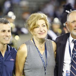 Max Schachter, Susan Hersbt and Dr. David Mills pose for a picture while the band was honoring Parkland shooting victim, Alex Schachter