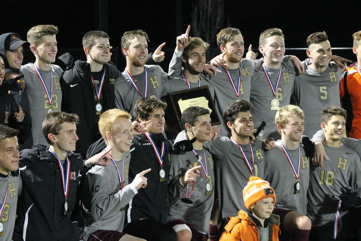 The Haverford School soccer team poses after winning a state title Saturday night