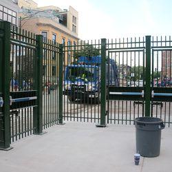 5:50 p.m. The gate in the right-field corner -