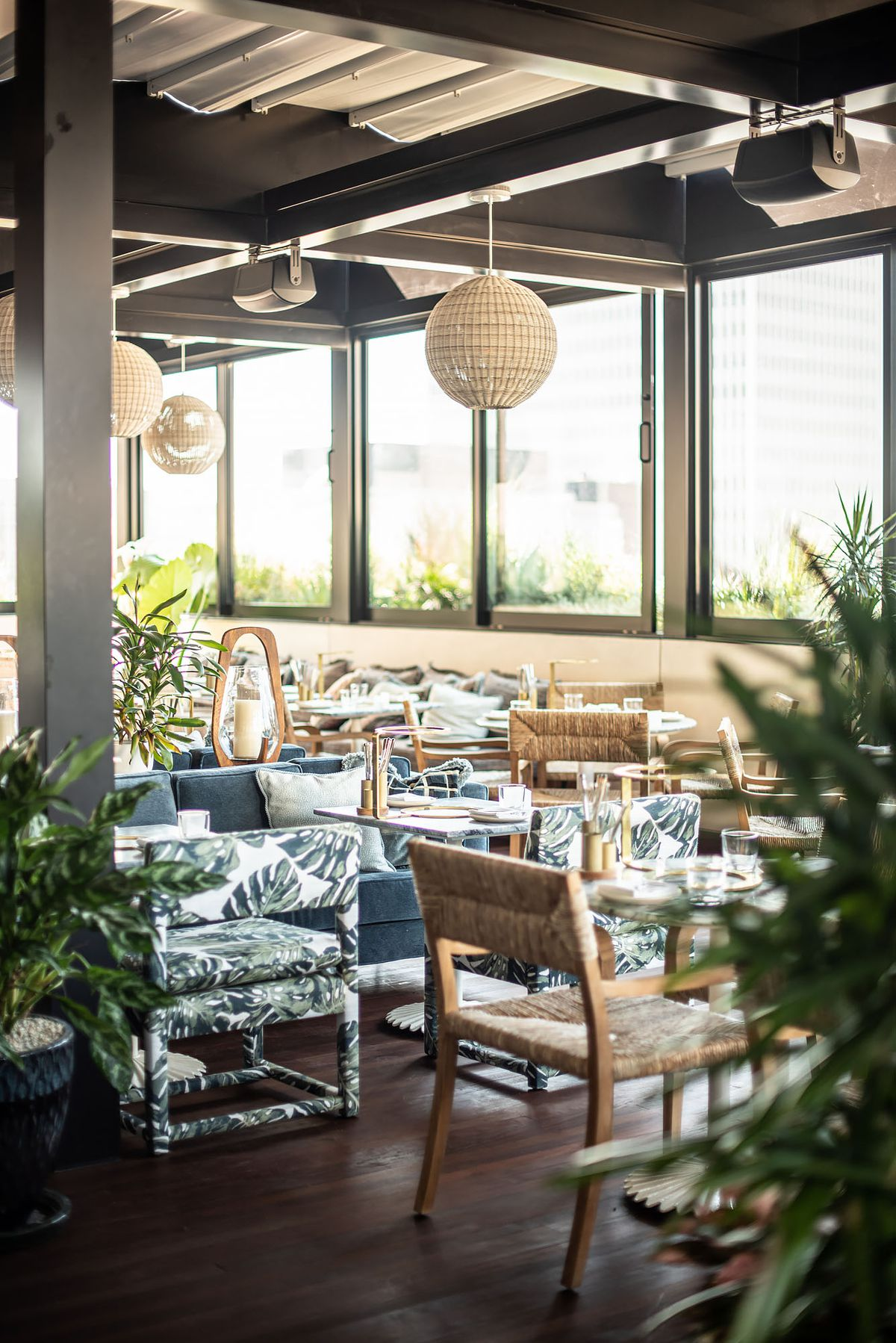 Leafy touches inside a rooftop restaurant.