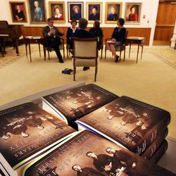"""Books are stacked in the foreground as co-editors of """"The First Fifty Years of Relief Society,"""" released by the LDS Church on the Church Historian's Press, are interviewed at the Relief Society Building in Salt Lake City, Monday, Feb. 22, 2016."""