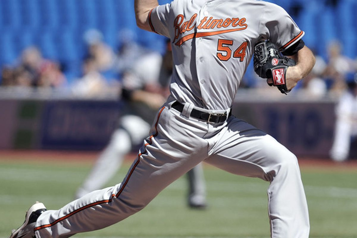TORONTO, CANADA - SEPTEMBER 10:  Rick VandenHurk #54 of the Baltimore Orioles delivers a pitch during MLB game action against the Toronto Blue Jays September 10, 2011 at Rogers Centre in Toronto, Ontario, Canada. (Photo by Brad White/Getty Images)