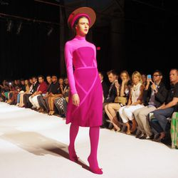 The very covered-up looks included this eye-popping magenta dress from Camelia Skikos.