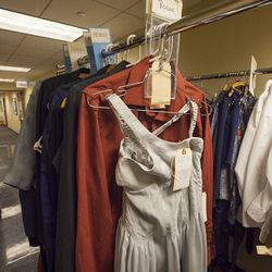 During rehearsals, the costumes hang on racks in the studio's hallway. They're labeled by dancers' last names.