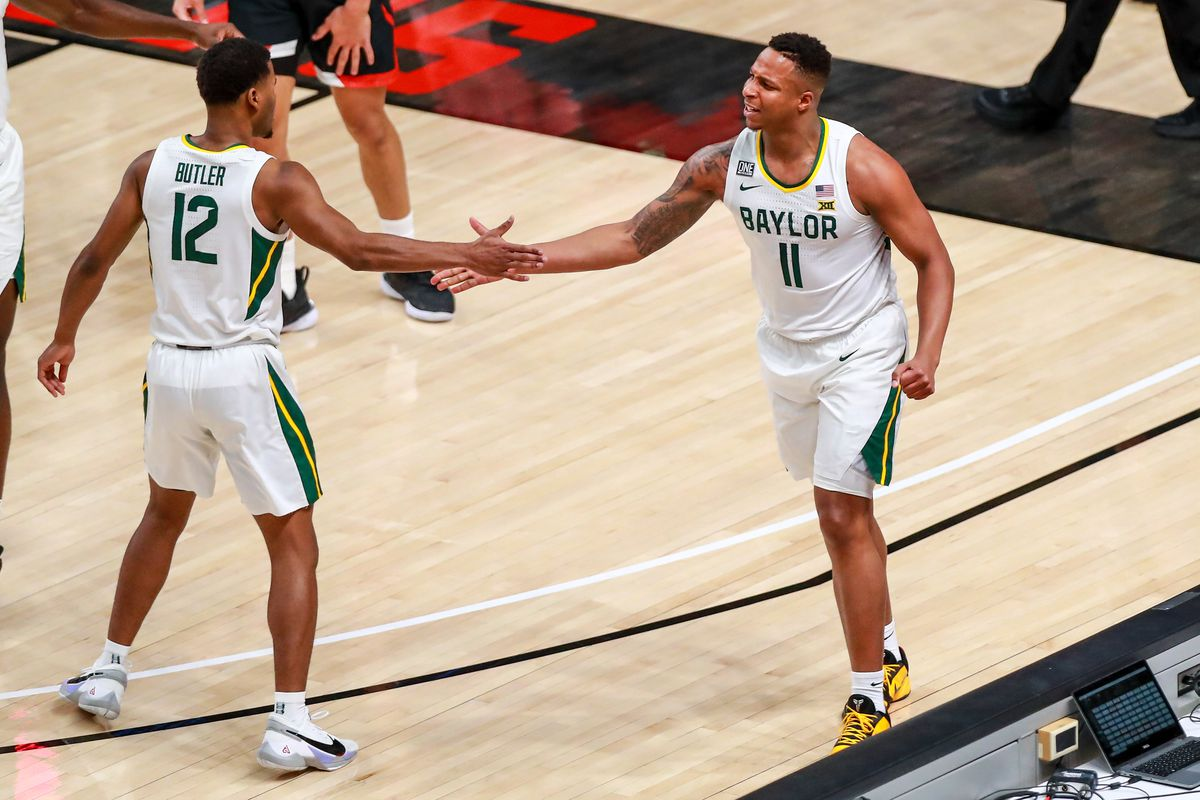 Mark Vital and Jared Butler of the Baylor Bears high five during the first half of the college basketball game against the Texas Tech Red Raiders at United Supermarkets Arena on January 16, 2021 in Lubbock, Texas.