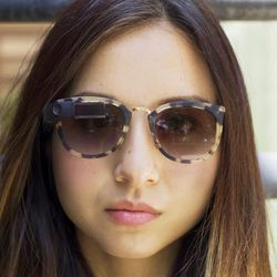 Amanda Rosenberg wearing frames designed especially for her by Isabelle Olssen