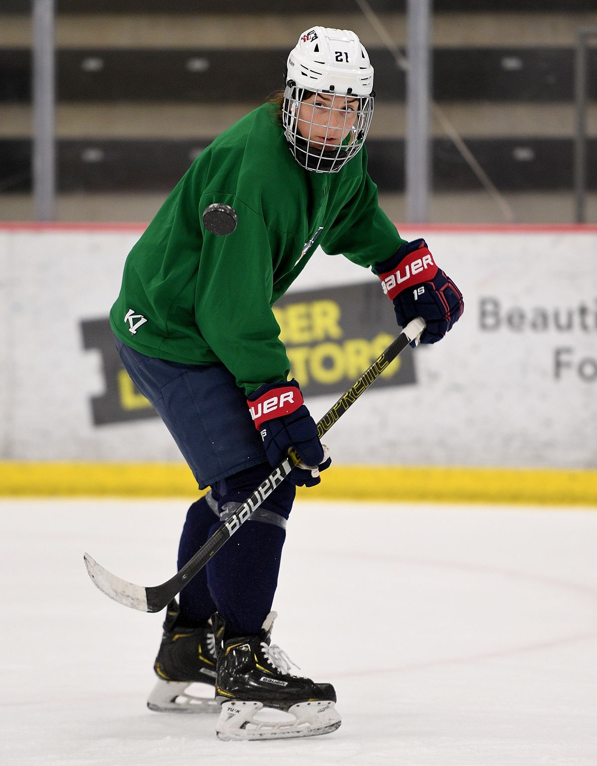Hilary Knight #21 of the United States flips a puck during the practice.