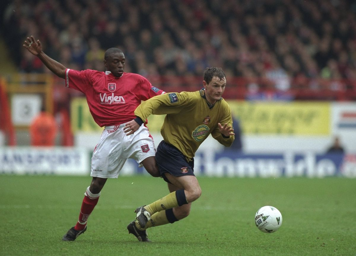 Alan Johnston of Sunderland chases a ball as he gets tackled by Charlton Athletic's Shaun Newton