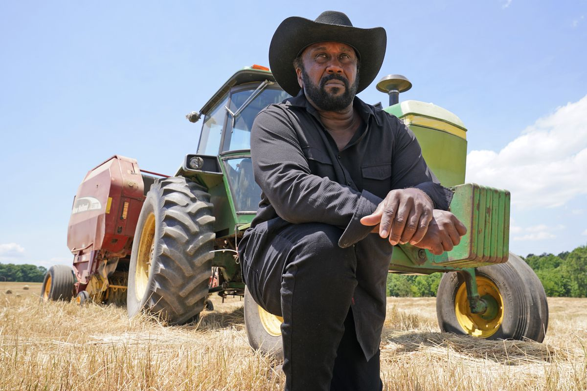 John Boyd Jr., taking a break from bailing hay at his farm in Boydton, Va. Documents from a USDA internal review show investigators found his operating loan requests weren't processed for years despite explicit instructions from the agency's state director.