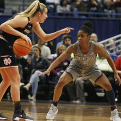 Notre Dame's Marina Mabrey (3) is guarded by UConn's Crystal Dangerfield (5) during the Notre Dame Fighting Irish vs UConn Huskies women's college basketball game in the Women's Jimmy V Classic at the XL Center in Hartford, CT on December 3, 2017.