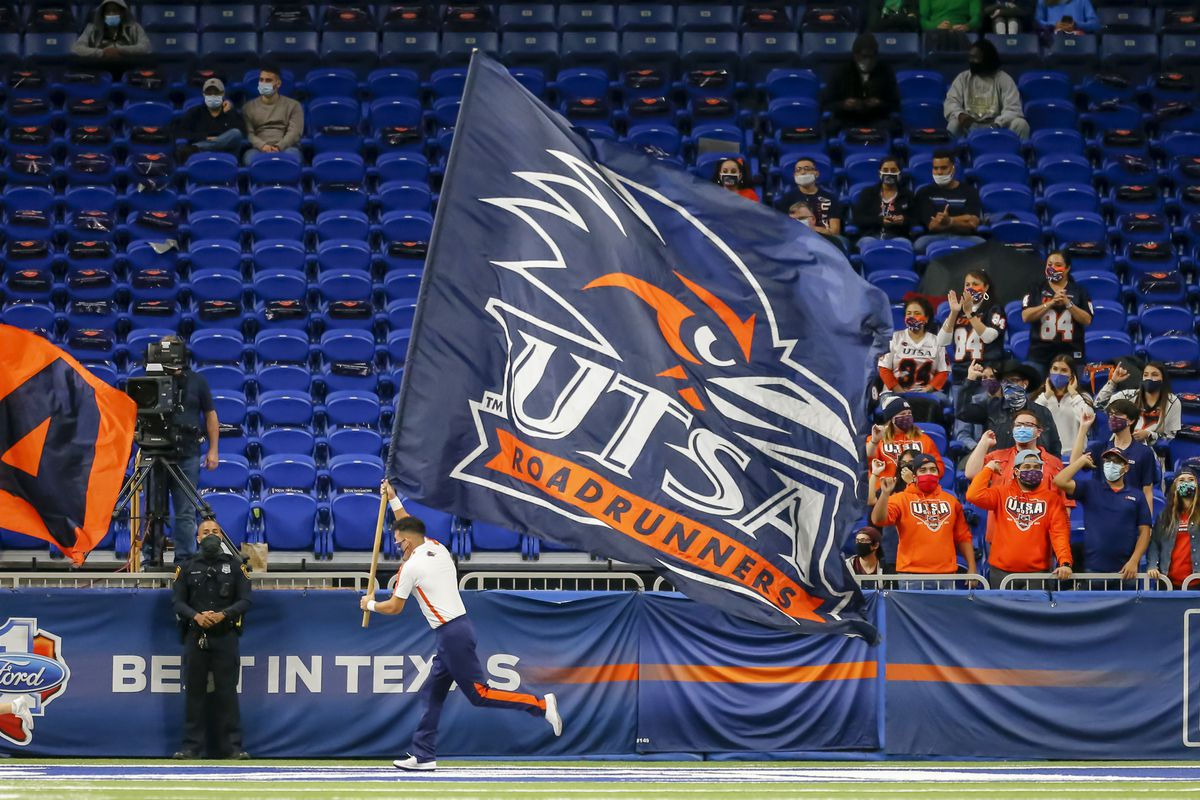UTSA Roadrunners spirit squad runs with a flag after a touchdown during the game between the UTSA Roadrunners and the North Texas Mean Green on Saturday 28, 2020 at Alamodome in San Antonio, Texas.