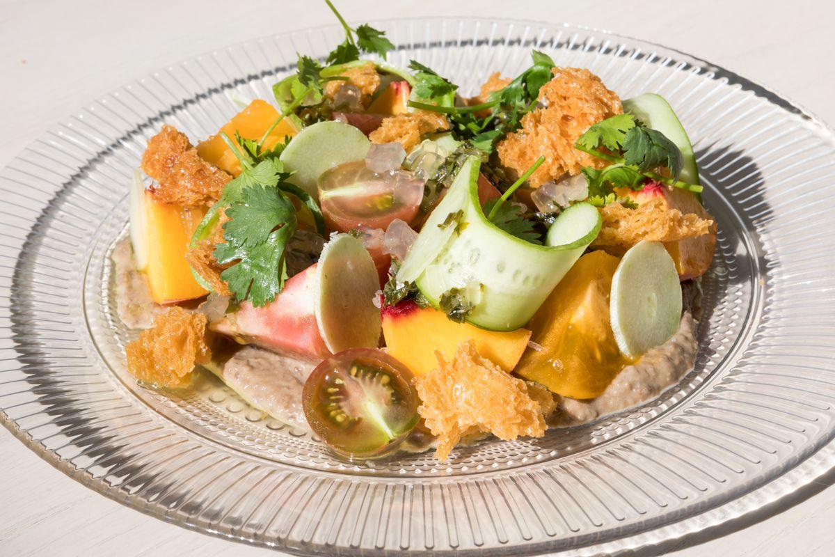 Tomato and peach salad with mung bean puree and fish tinapa condiment