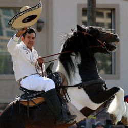 A rider from the Consulate of Mexico in Salt Lake City rides a horse during the Days of '47 Parade in Salt Lake City on Friday, July 23, 2021.
