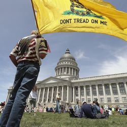 David Christiansen holds a flag during an Interfaith Spiritual Revival at the Capitol in Salt Lake City on Saturday, May 16, 2020. The event was for all beliefs who support the First Amendment.