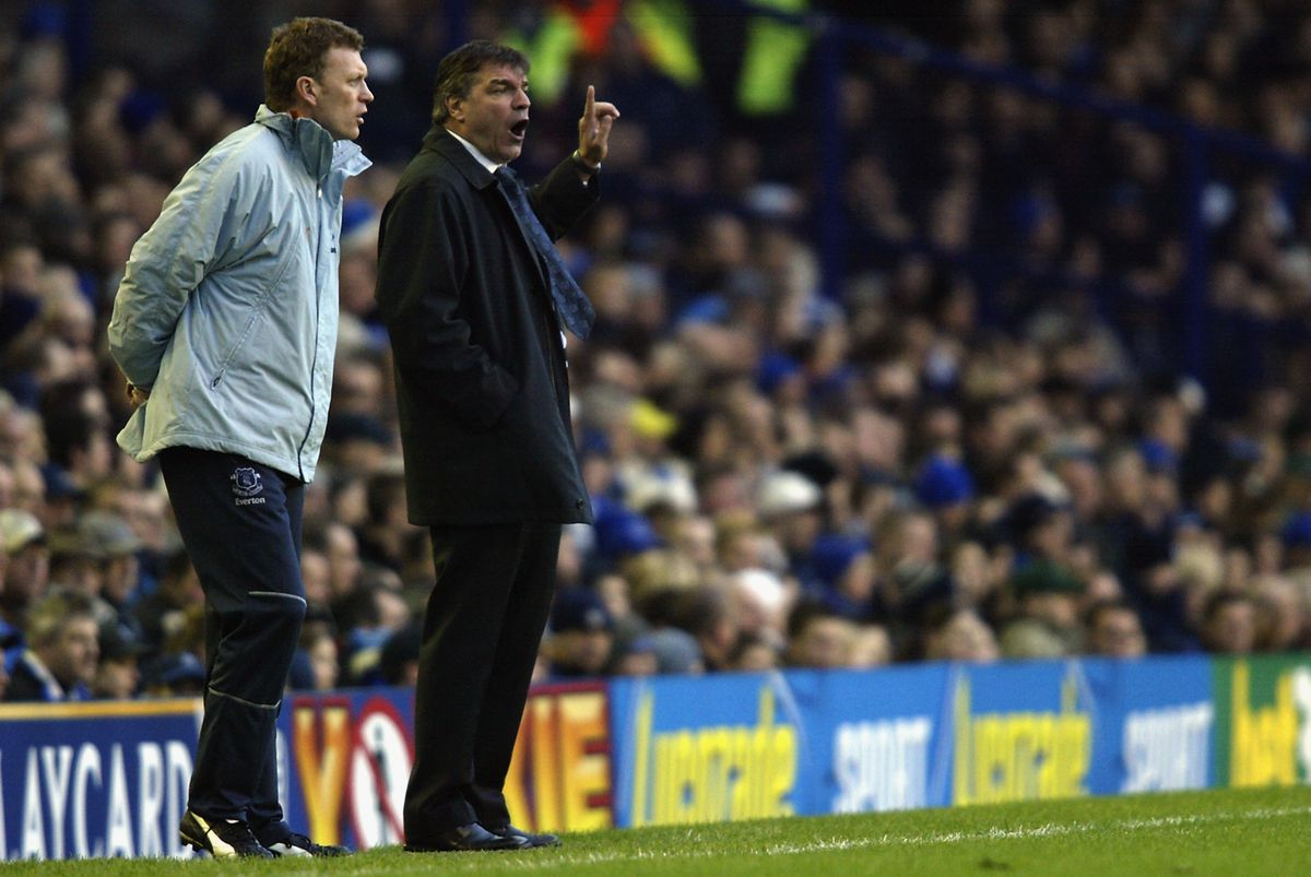 Everton manager David Moyes and Bolton Wanderers manager Sam Allardyce watch play from the sidelines