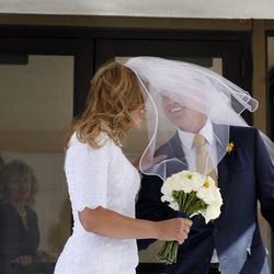Michelle Oliverson and Tyler Newman laugh as the wind catches her veil after their wedding ceremony at the Salt Lake LDS Temple on Friday, March 2, 2012. The two met when Tyler bought Michelle's bicycle from the KSL Classifieds.
