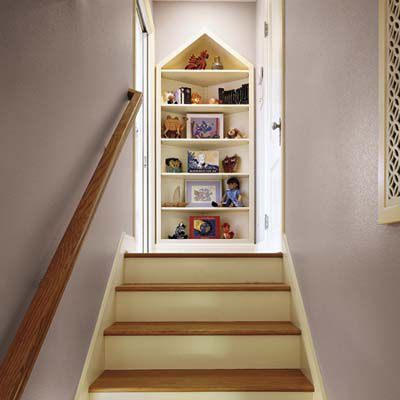 <p>A three-corner built-in with a triangular top provides display space and points the way up the new full-height front stairs.</p>