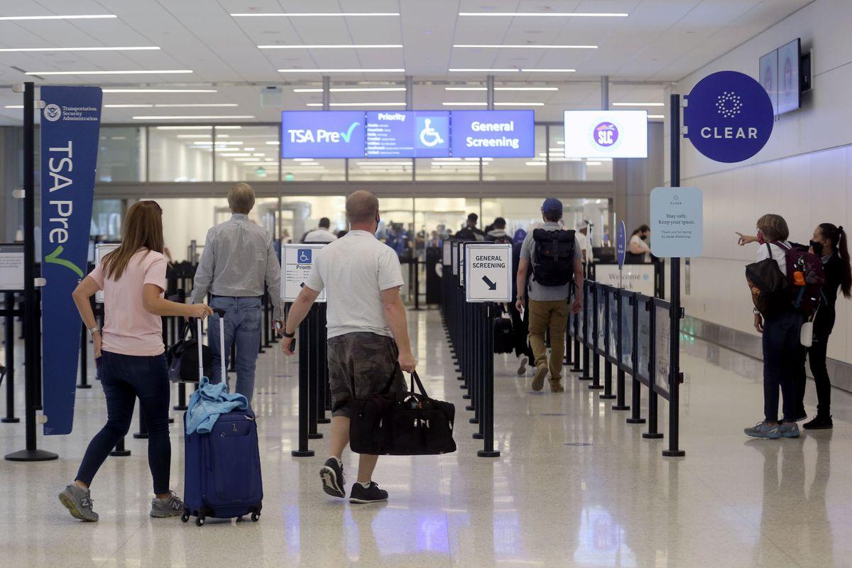 Travelers walk through the new Salt Lake City International Airport.