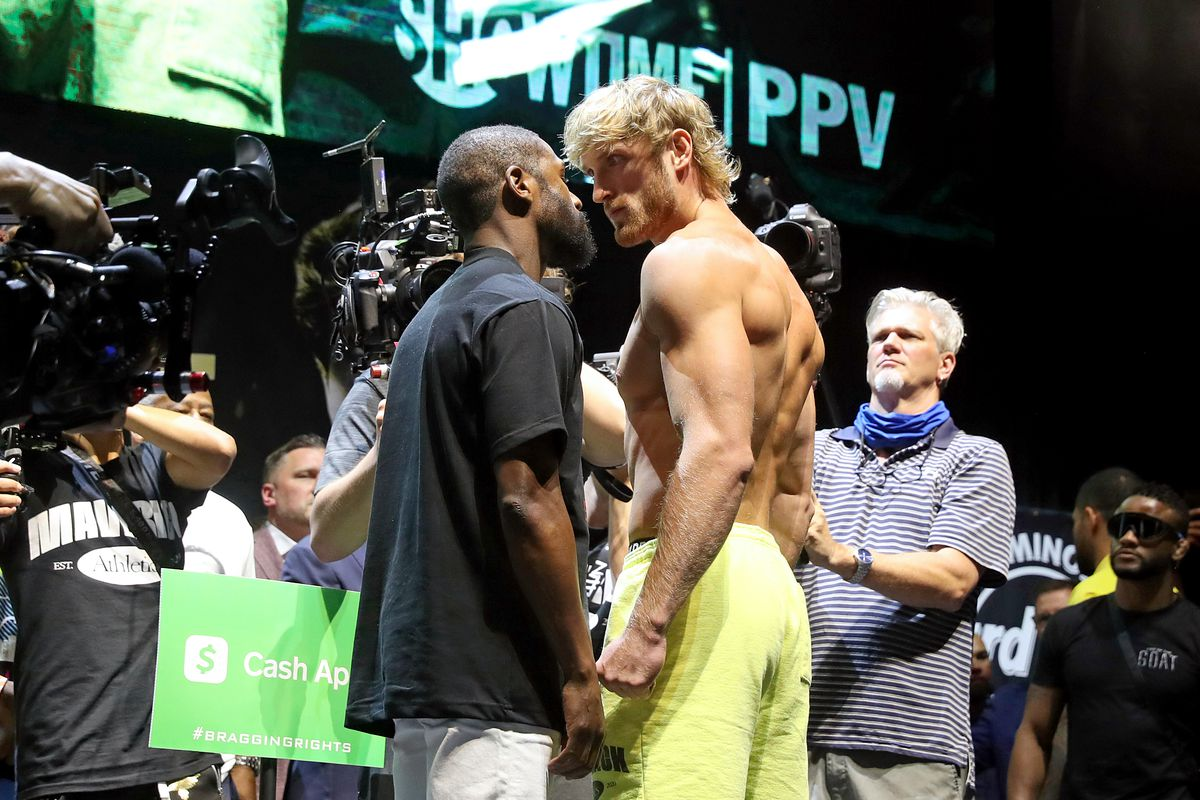 Floyd Mayweather and Logan Paul face off during the weigh-in ahead of the June 6th exhibition boxing match between Floyd Mayweather and Logan Paul on June 5, 2021 at Hard Rock Live at Seminole Hard Rock Casino in Miami Gardens, Florida.