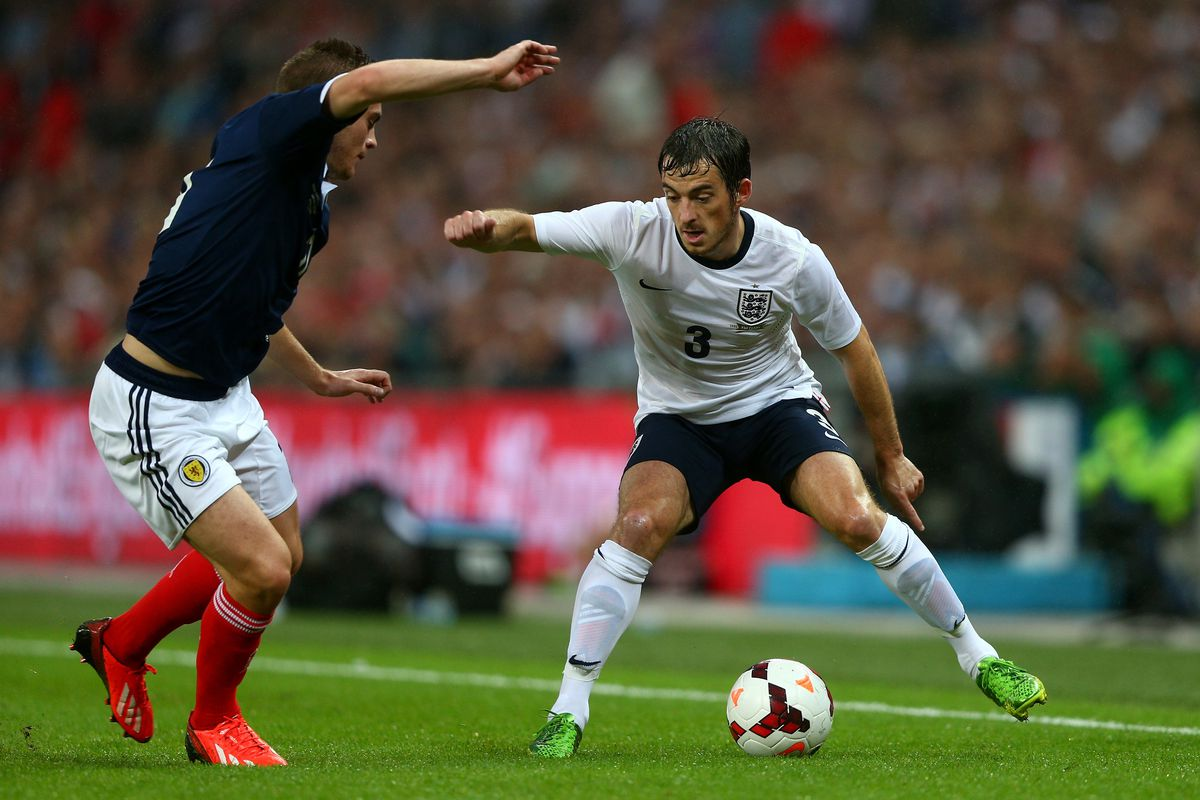 Leighton Baines takes on a defender for England in their win over Scotland on Wednesday at Wembley.