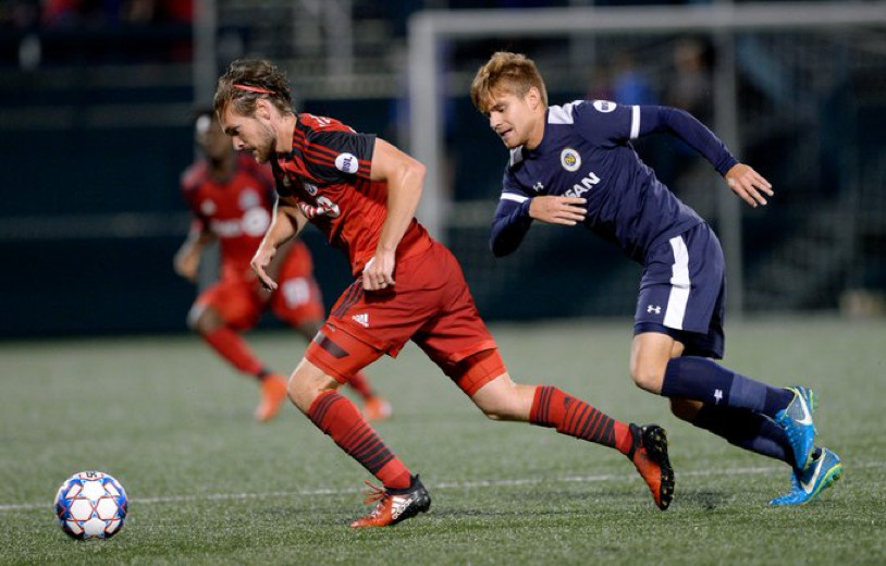 USL Photo - Toronto FC II's Kyle Bjornethun escapes the marking of a Nashville defender in Rochester during their first win of the season