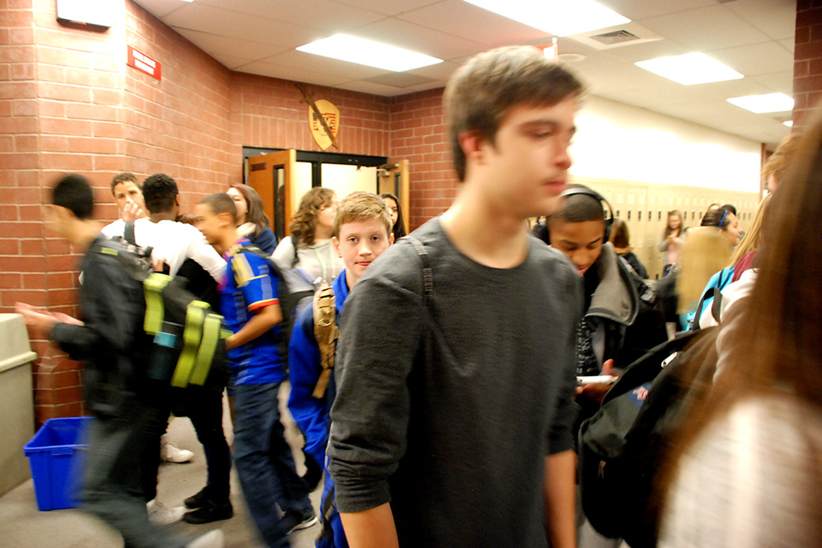 Students at Rangeview High School in Aurora walk through the hall during passing period.