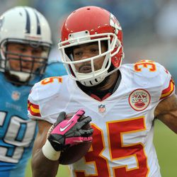Oct 6, 2013; Nashville, TN, USA; Kansas City Chiefs defensive back Quintin Demps (35) runs with the against Tennessee Titans center Robert Turner (59) after intercepting a pass during the second half at LP Field. The Chiefs won 26-17.
