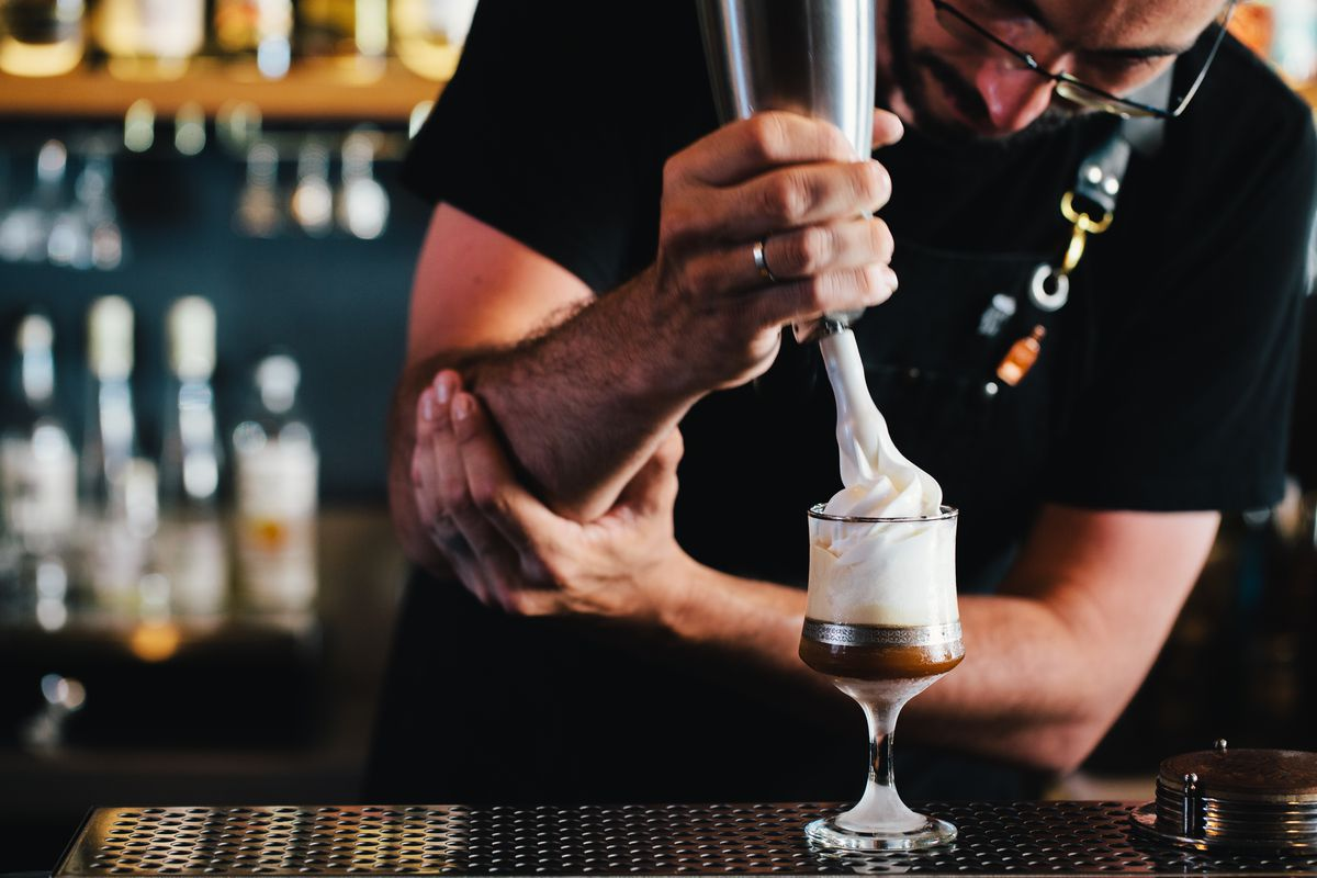 A whipped-cream topped martini in the making at the Black Pearl