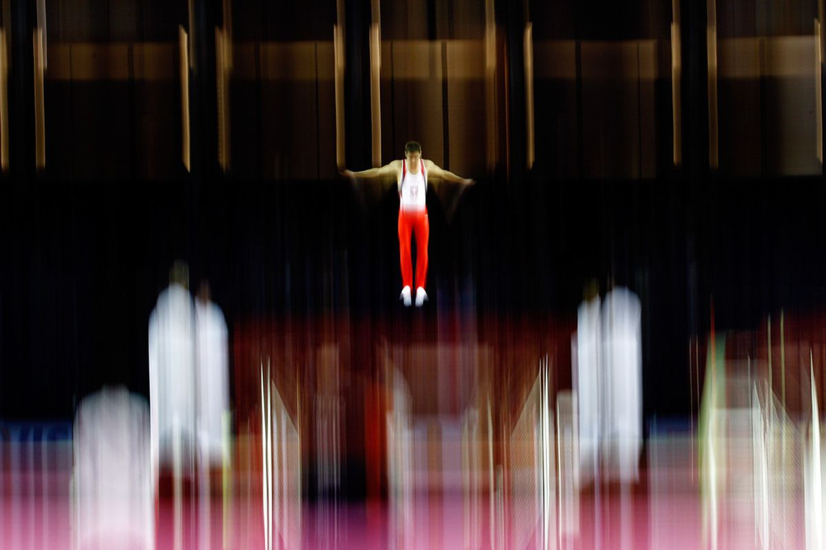 LONDON, ENGLAND :Nicolas Schori of Switzerland in action during the Gymnastics Trampoline Olympic Qualification round at North Greenwich Arena on January 13, 2012 in London, England.  (Photo by Paul Gilham/Getty Images)