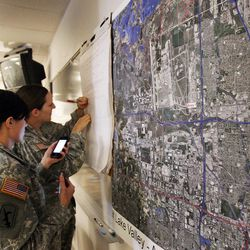 Staff Sgt. Gloria Crossett and Sgt. Mercedes Millward of the Utah National Guards 300th Military Intelligence work out of a fire station during The Great Utah ShakeOut in Salt Lake County  Tuesday, April 17, 2012. This is the  largest earthquake drill ever conducted in Utah history.