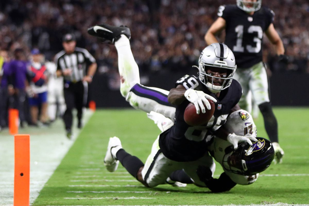 Las Vegas Raiders wide receiver Bryan Edwards (89) is stopped short of the goal line by Baltimore Ravens cornerback Brandon Stephens (21) during overtime at Allegiant Stadium.