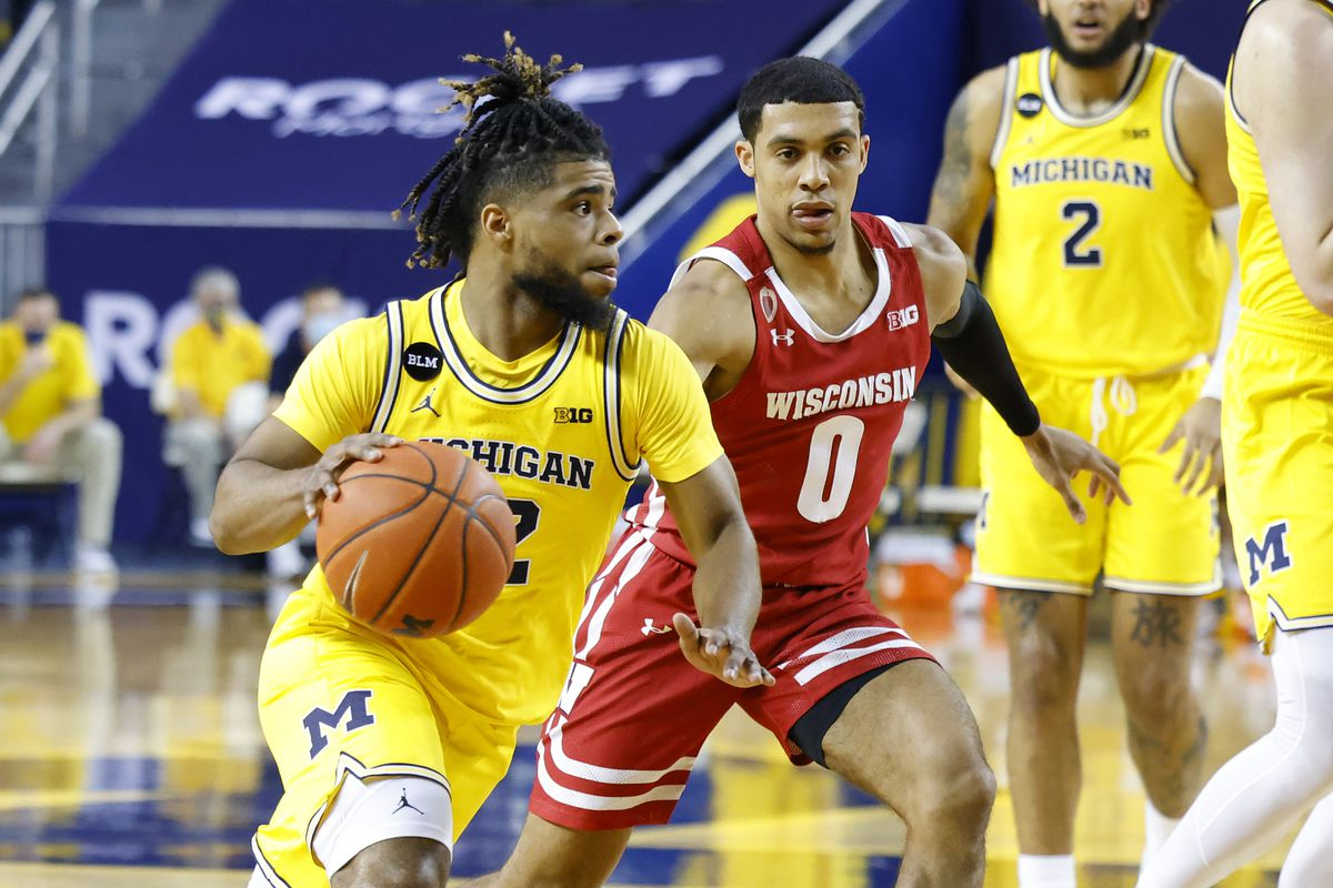 Michigan Wolverines guard Mike Smith dribbles against Wisconsin Badgers guard D'Mitrik Trice in the first half at Crisler Center.