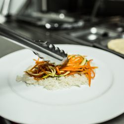 A bed of jasmine rice is topped with shredded zucchini and carrots, a decidedly fresh departure from greasy refried beans.