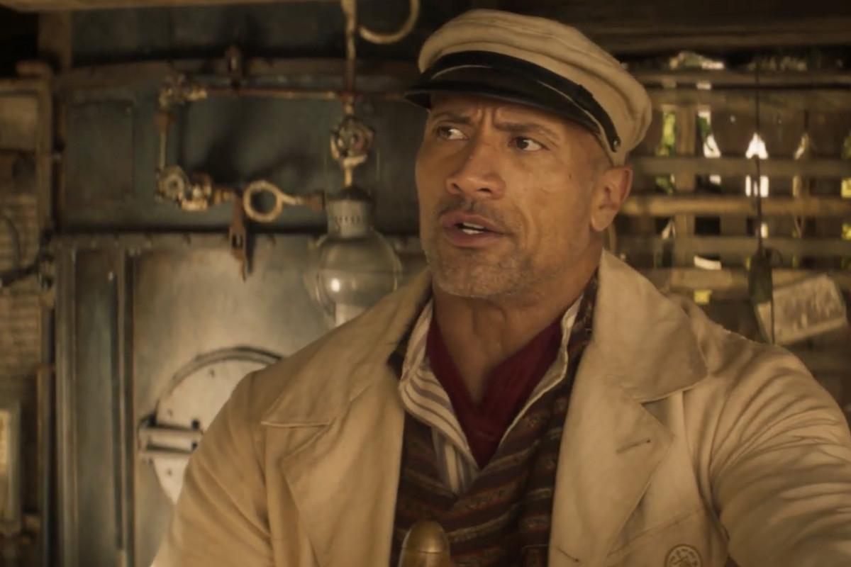 dwayne the rock johnson in a smoldering hot jungle cruise skipper uniform