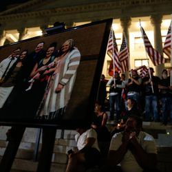 A family portrait of Marine Staff Sgt. Taylor Hoover is pictured at a vigil to honor Hoover's life and service at the Capitol in Salt Lake City on Sunday, Aug. 29, 2021. Hoover was one of the 13 U.S. service members killed by the terrorist attack at Hamid Karzai International Airport in Kabul, Afghanistan.